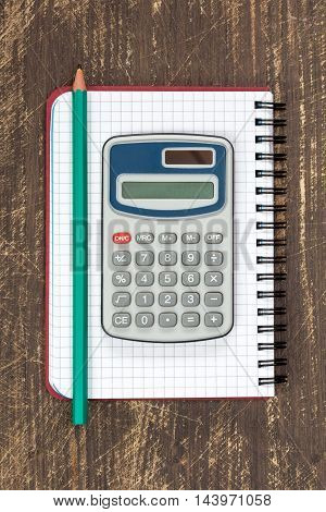 Digital calculator and spiral notebook with pencil.Top view.