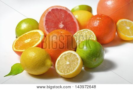 Various citrus fruits on white background, close up