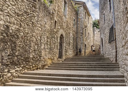 GIRONA SPAIN - JULY 6 2016: Ancient medieval street in Girona Catalonia Spain