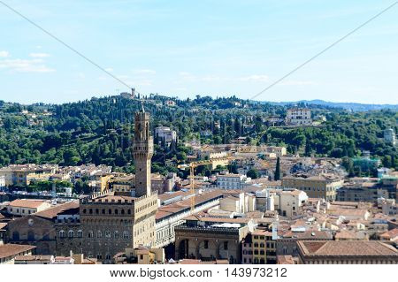 Panorama of city rooftops and Palazzo Vecchio from Campanille in Florence, Italy