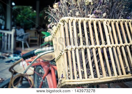 Retro Vintage Red Bike With Dry Flower In Basket