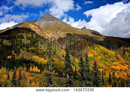 Beautiful autumn Colorado mountain landscape of gold green and blue colors in fall