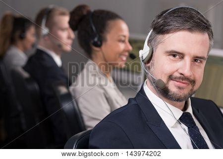 Portrait of handsome handsome helpline consultant wearing headset