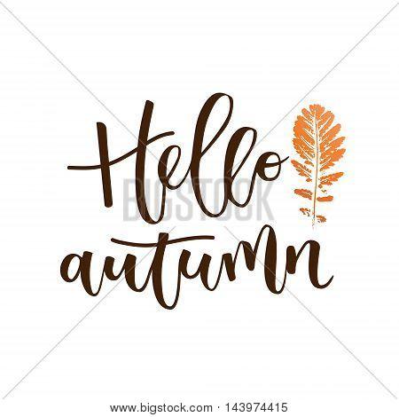 Hello autumn hand written inscription with orange leaf on white background