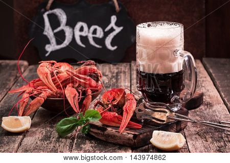 Boiled Crawfish And Beer On A Wooden Background