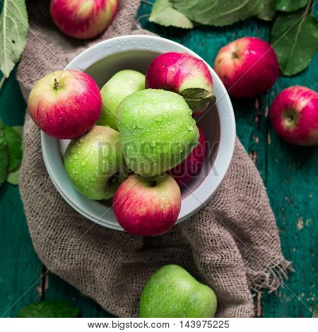 Red And Green Apples On Wooden Vintage Background