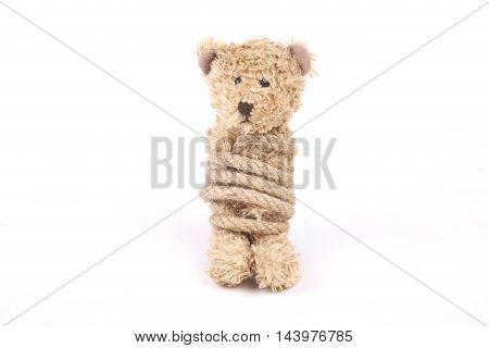 Teddy bear tied up with a rope bullying