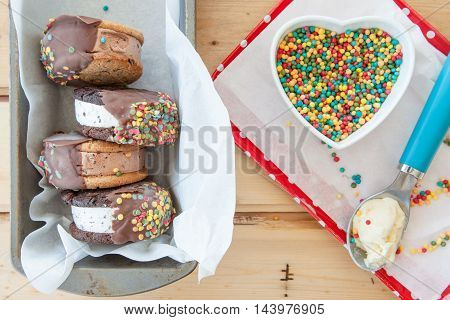 Chocolate covered ice cream sandwich with sprinkles