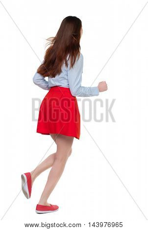 side view of running  woman. beautiful girl in motion. backside view of person.  Rear view people collection. Isolated over white background. Long-haired brunette in red skirt runs diagonally