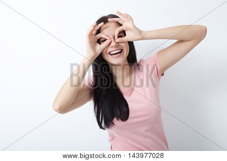 Beauty woman with white perfect smile looking at camera in studio on white