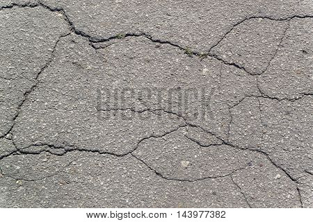 Texture of the old road with cracks