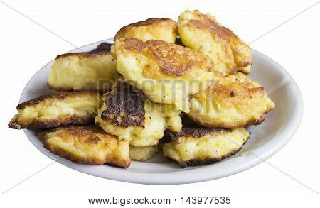 Tasty home cheese pancakes in plate insulated on white background