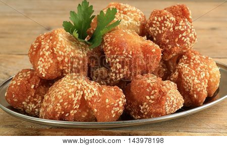 marasay indian sweet fried rice balls dipped in sesame seeds