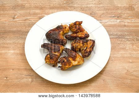 Plate of delicious barbecue chicken wings on the table