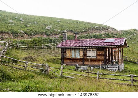 traditional wooden plateau house on mountains in Turkey