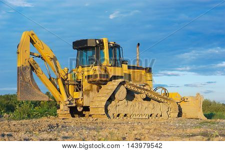 Big heavy yellow bulldozer on construction site