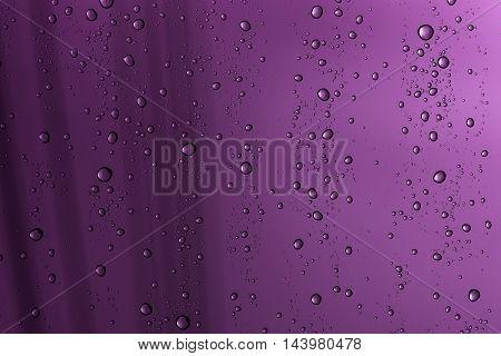 patterntexture : rain drop on window glass in rainy day purple effect