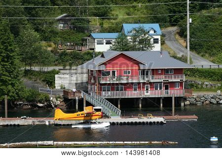 A plane parked behind a house in Ketchikan Alaska