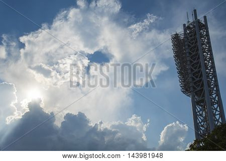 Stadium lighting tower and stormy cloudy sky