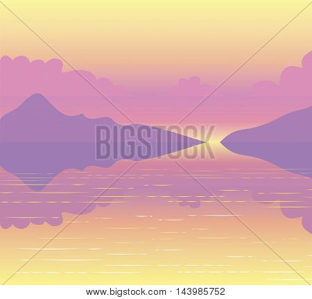 Scenic landscape pink sunset passing over the mountains and reflected on the water surface of the lake