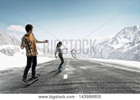 Teenagers ride skateboard . Mixed media