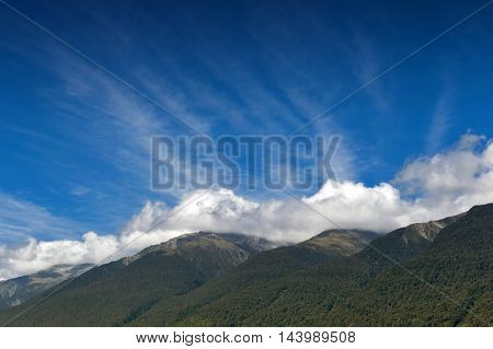 Cloudy blue sky and mountains in Otago region south island of New Zealand