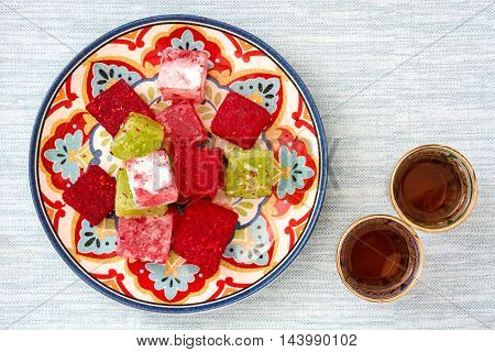 Turkish delights and tea on blue background