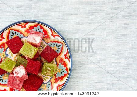 Turkish delights on plate and blue background
