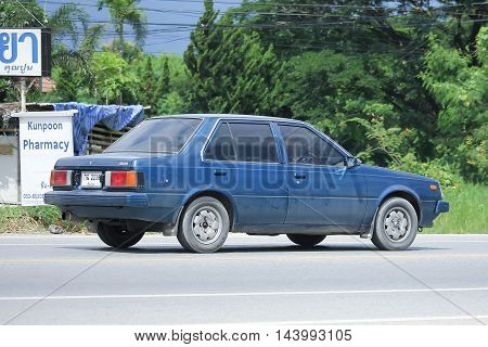 CHIANGMAI THAILAND -AUGUST 9 2016: Private old car Nissan Sunny. On road no.1001 8 km from Chiangmai Business Area.