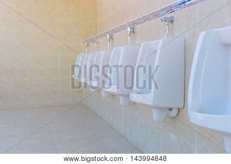 Urinals Men public in toilet room wc.