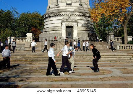 New York City - November 2 2005: Jewish students from a local Yeshiva school playing soccer in the Soldier's and Sailor's Monument plaza in Riverside Park