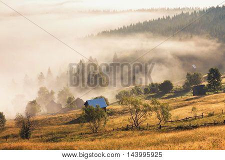 Summer sunny sunrise above the villages, at Bucovina - Romania