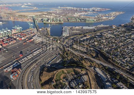 Los Angeles, California, USA - August 16, 2016:  Afternoon aerial view of the Port of Los Angeles, Vincent Thomas Bridge and the community of San Pedro.