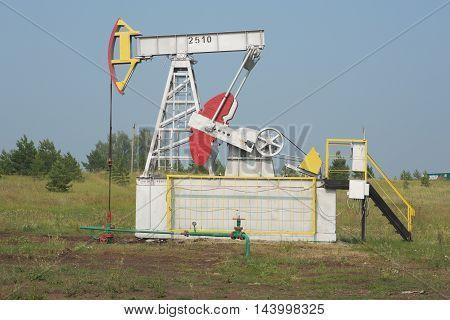the oil pump pumps oil in a field