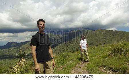 SIERRA VISTA, ARIZONA, AUGUST 21. Coronado Peak on August 21, 2016, near Sierra Vista, Arizona. A pair of men hike the trail on top of Coronado Peak in the Huachuca Mountains near Sierra Vista Arizona.