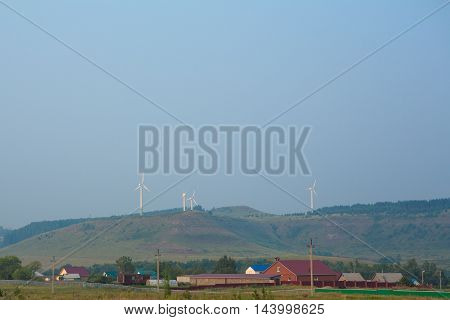 large group of windmills for renewable electric energy