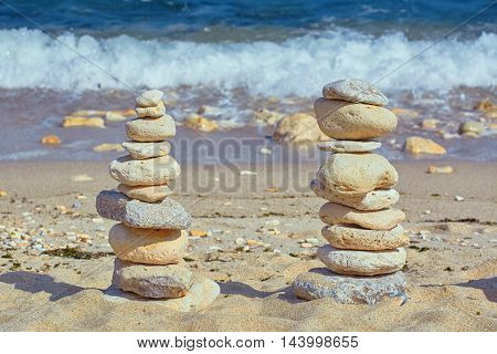 Pyramid of Pebbles against of the Sea