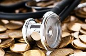 Concept of expensive health care with coins and stethoscope