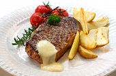 stock photo of porterhouse steak  - Grilled New York strip steak with bearnaise sauce - JPG