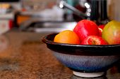 stock photo of fruit bowl  - Interior of a modern kitchen with natural granite countertop - JPG