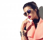 Beauty Fashion model girl with brown hair wearing stylish sunglasses. Sexy woman portrait with perfe poster
