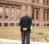 Man Reading Historical Marker poster