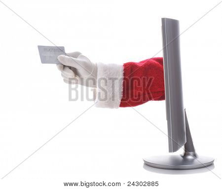 Santa Claus arm sticking through a computer screen holding a credit card representing e-commerce or on-line shopping. Horizontal format over white background.