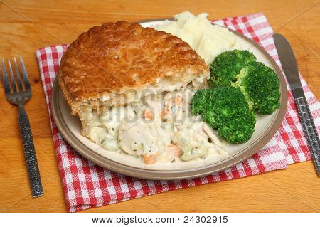 Chicken pie with mashed potato and broccoli