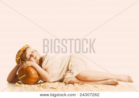 small girl with pumpkin