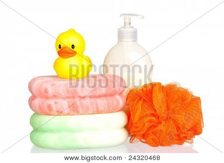 Yellow plastic duck over sponges and boat bath dispenser isolated on a over white background