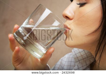 Woman With Glass Of Mineral Water