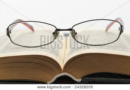 Eyeglasses On The Old Thick Book