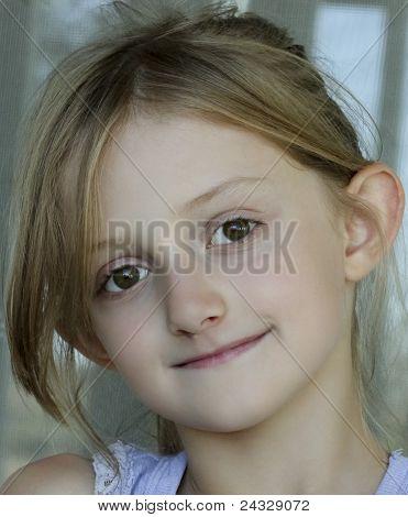 An Ash Blonde Little Girl With Hazel Eyes