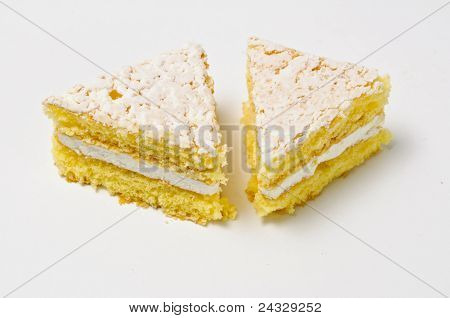 Two Triangles Of Sponge Cookies With Skimming Filling